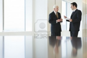 5579445-two-businessmen-in-focus-in-the-background-